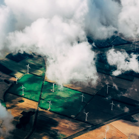 Aerial View Of Wind Turbines On Agricultural Field